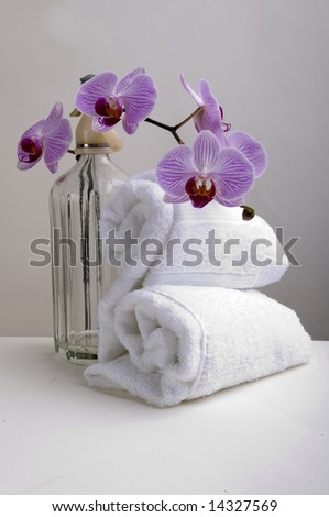 Towels, orchids and soda on luxury spa - stock photo