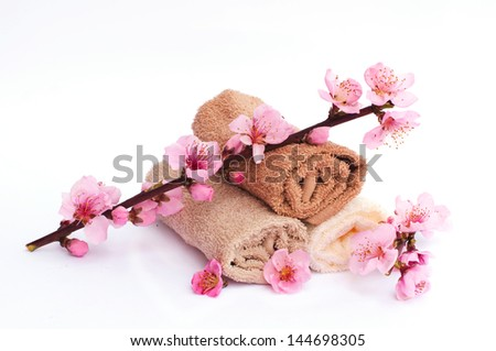 Towels set with flowers for spa - stock photo