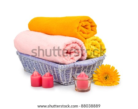 Towels, shell, candles and flower isolated on a white background