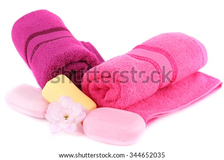 Towels, soaps and flower isolated on white background. - stock photo