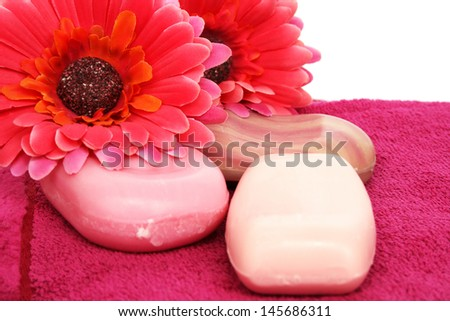 Towels, soaps and flowers on white background. - stock photo