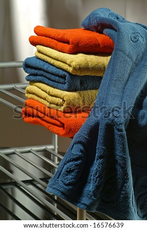 towels soft on metallic shelf - stock photo