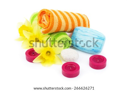 towels with flowers and candles on a white background