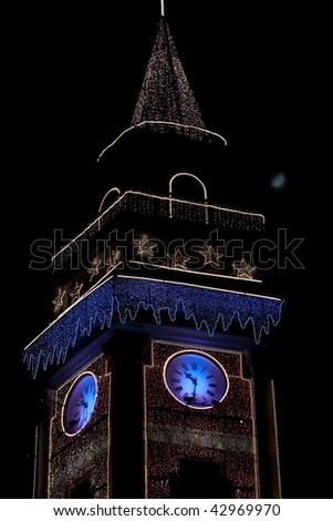 tower adorned with garlands of night - stock photo