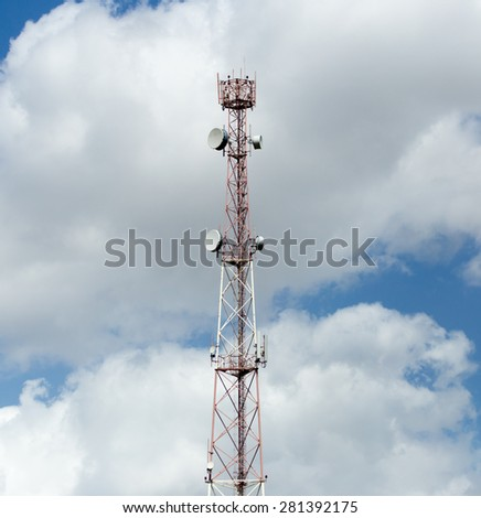 Tower against the sky with clouds - stock photo