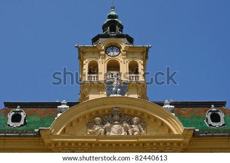 Tower and facade ornaments of town hall in Szeged, Hungary - stock photo