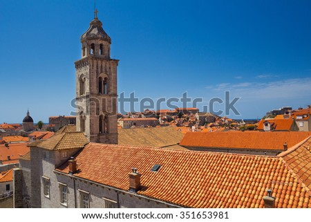 Tower and red roofs of Dominican Church and Monastery in Dubrovnik from the old town walls, Croatia - stock photo