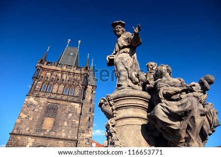 Tower and statue at the Charles Bridge in Prague, Czech Republic - stock photo