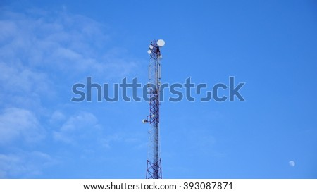 Tower antennas, GSM mobile communication against the blue sky with the moon - stock photo