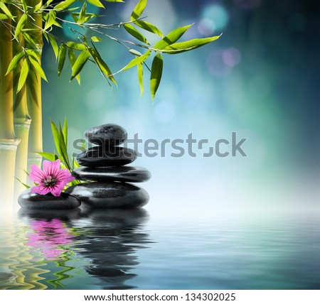 tower black stone and hibiscus with bamboo on the water - stock photo