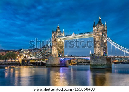 Tower Bridge an iconic symbol of London at night in England. - stock photo