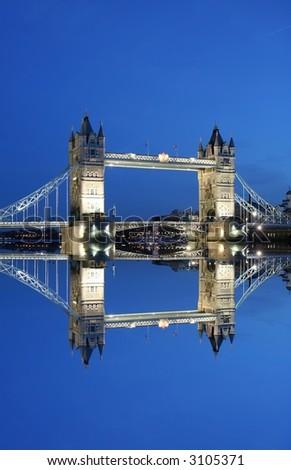 Tower Bridge and reflection at night - stock photo