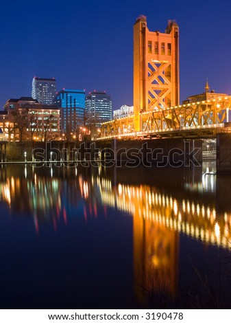 Tower Bridge and Sacramento downtown at night - stock photo