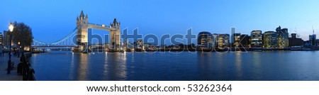 Tower Bridge and the Thames panoramic view about London at night - stock photo