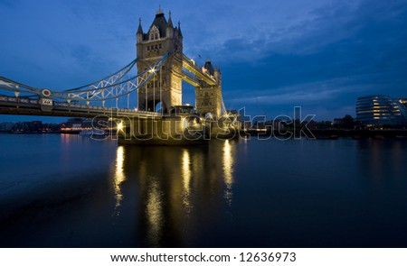 tower bridge at dusk with vibrant blue sky - stock photo