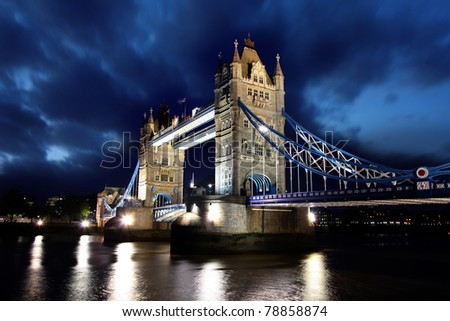 Tower Bridge at night in London, UK - stock photo