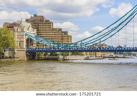 Tower Bridge - iconic symbol of London. It is a combined bascule and suspension bridge in London, over River Thames. Tower Bridge is close to Tower of London, from which it takes its name.
