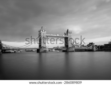 Tower Bridge in black and white taken with a long exposure. There is copy space on the image. - stock photo