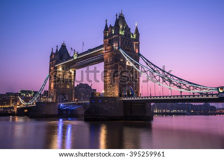 Tower Bridge in London at sunrise, reflection in water nice cool colors at frosty morning.