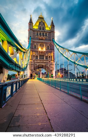 Tower Bridge in London by night vertical composition. - stock photo