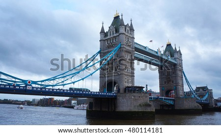 Tower Bridge in London in the late cloudy afternoon.