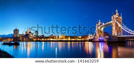 Tower Bridge in London, the UK at night. Panorama of the city centre - stock photo