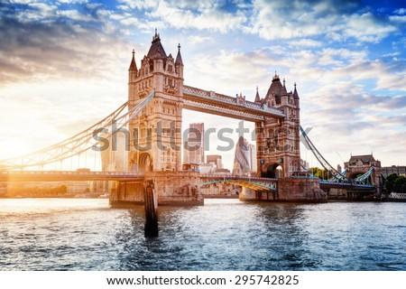 Tower Bridge in London, the UK. Sunset with beautiful clouds. Drawbridge opening. One of English symbols - stock photo