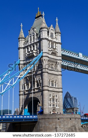 Tower Bridge in London with the Gherkin in London. - stock photo