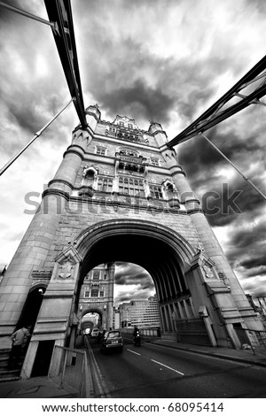 Tower Bridge London England with street traffic - stock photo