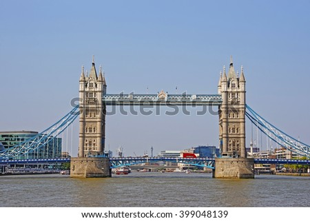Tower Bridge over River Thames in London, UK. Tower Bridge is a combined bascule and suspension bridge in London.  It crosses the River Thames and has become an iconic symbol of London. - stock photo