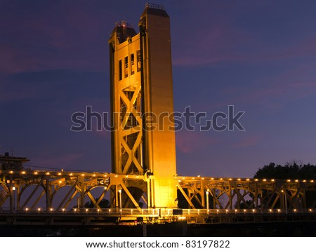 Tower Bridge over Sacramento River lights at night - stock photo