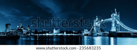 Tower Bridge panorama over Thames River at night in London - stock photo