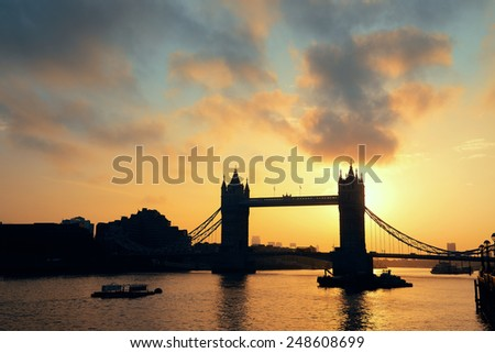 Tower Bridge silhouette over Thames River in London. - stock photo