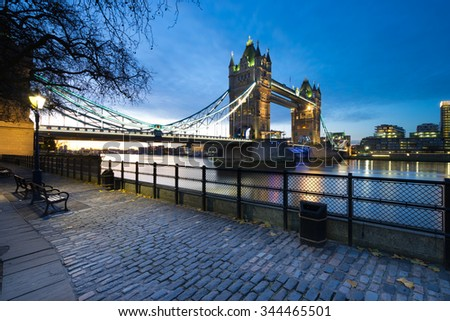 Tower Bridge viewed from Tower of London side of the Thames river at night before the sunrise in London, England. - stock photo