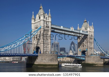 Tower Bridge with boat in London, England - stock photo