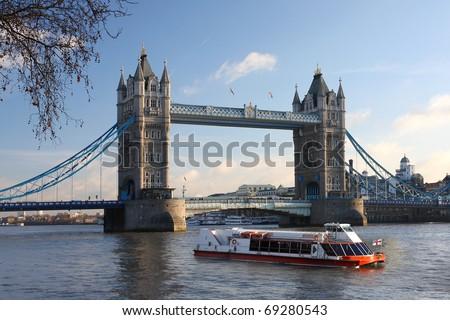 Tower Bridge with boat, London, UK - stock photo