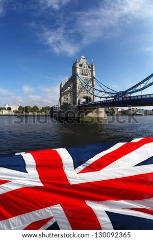 Tower Bridge with flag of England in  London - stock photo