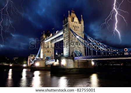 Tower Bridge with lightnings at stormy night in London, UK - stock photo
