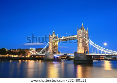 Tower Bridge with reflections in the thames river at sunset in London, United Kingdom, England - stock photo