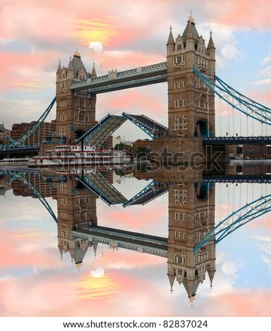 Tower Bridge with steam boat against sunset over the bridge in London, UK - stock photo