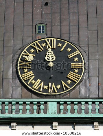 Tower clock of the  famous Dome Cathedral (Old town, Riga, Latvia) - stock photo