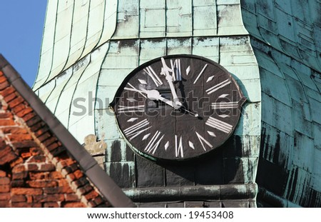 Tower clock of the famous St. Jacob?s Church (Old town, Riga, Latvia) - stock photo