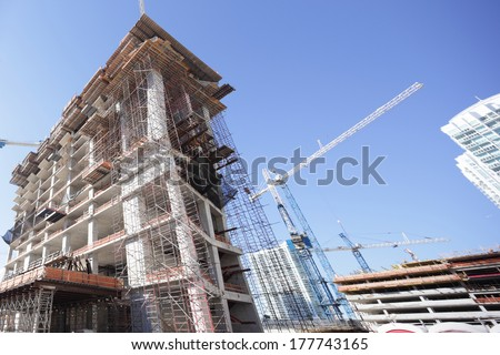 Tower construction and a crane - stock photo