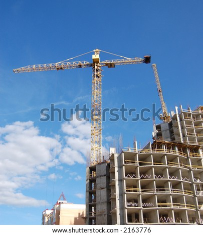 Tower crane and house-building