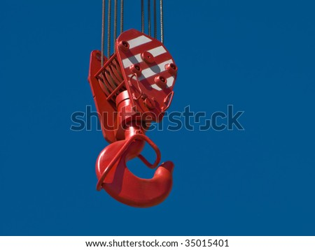 Tower crane and steel hook building metal construction - stock photo