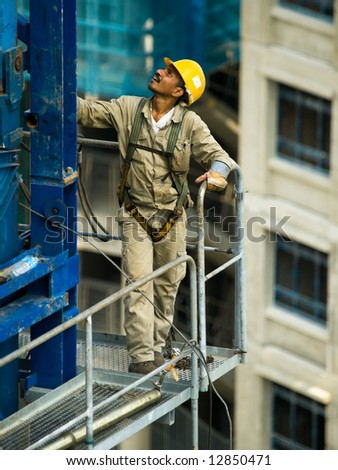 Tower Crane Construction Worker - stock photo