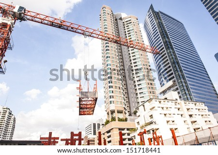 Tower crane lift slip form material at construction site - stock photo