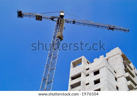 Tower crane over building - stock photo