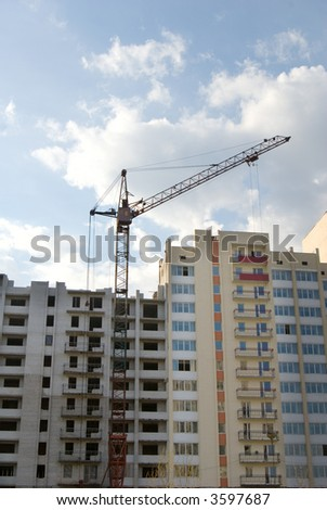 Tower crane over new building - stock photo