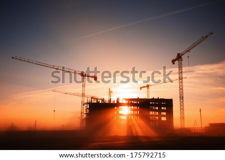 tower cranes at construction site - stock photo